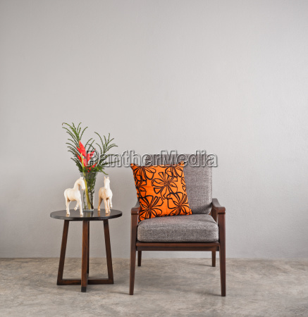 grey upholstered chair with flowers