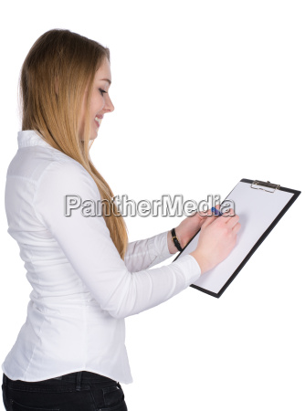 young woman writes on a clipboard