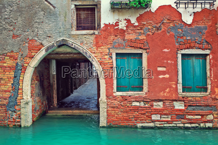 narrow canal and facade of old