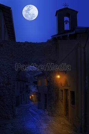 night view of narrow street between