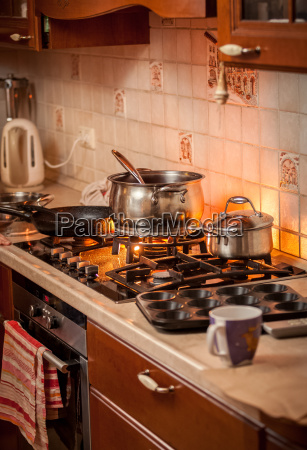 pan boiling on burning gas stove