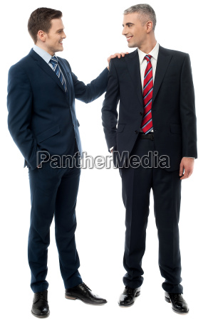 two business partners talking together