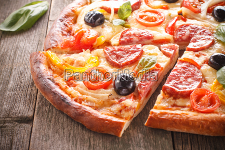 pizza with salami and vegetables on