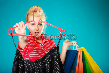 pinup girl buying clothes black skirt