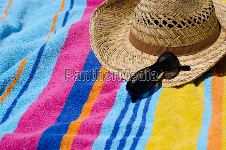 holiday concept with beach towel sun