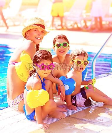 cheerful family on beach resort