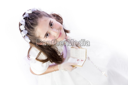 a young girl with rosary and