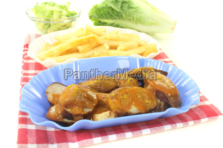 currywurst with french fries on a