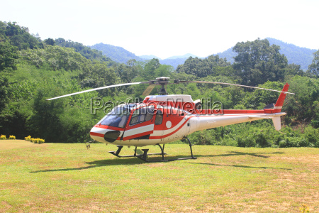 helicopter standing on landing strip