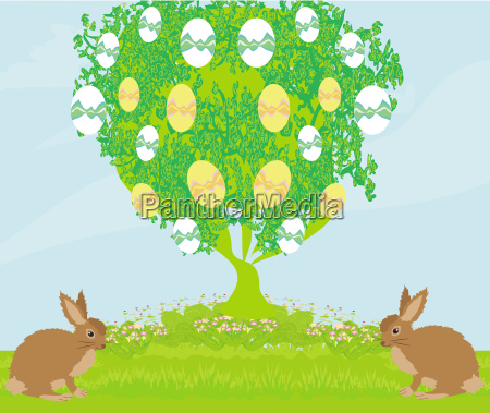 easter card with rabbits and tree