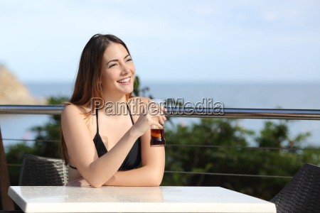 woman on vacation drinking in a