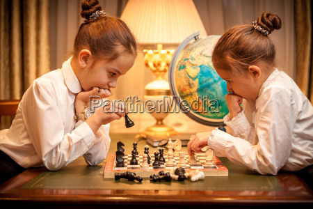 sisters playing chess