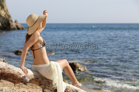 beauty woman on the beach looking