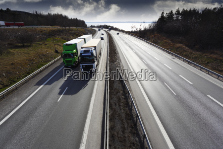giant motorway wide perspective with trucks