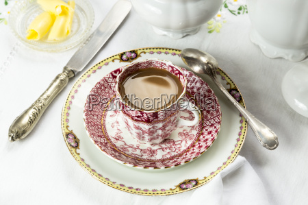 antique porcelain breakfast setting with coffee