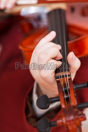 girl playing fiddle chord on