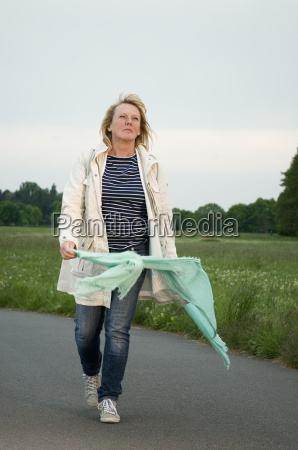 woman with scarf on a footpath