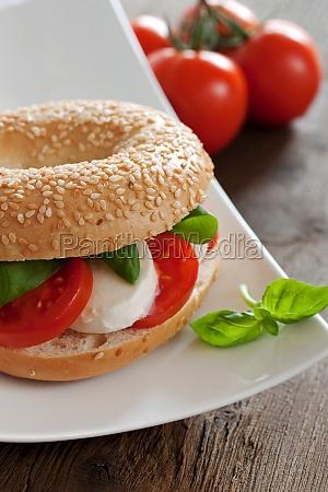 sesame bagel with mozzarella