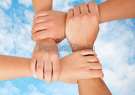 joined hands in a symbol of