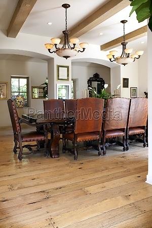 arranged dining table on hardwood floor