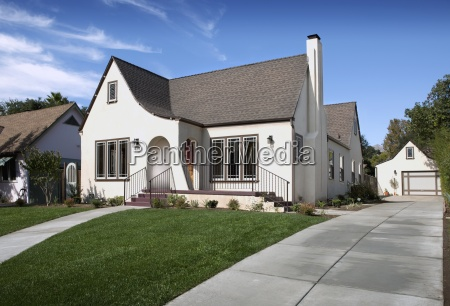 exterior of cottage with lawn in