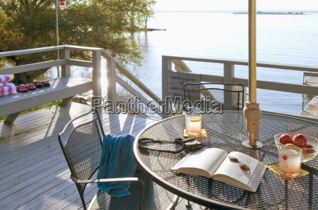 patio table on deck by lake