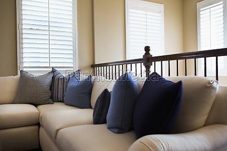 blue throw pillows on sofa tustin