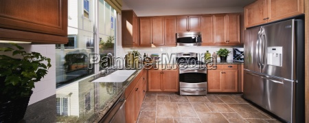 traditional kitchen with wooden cabinets tustin
