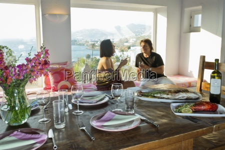 women enjoying drinks in dining room