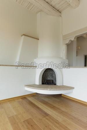 kiva fireplace in corner of empty