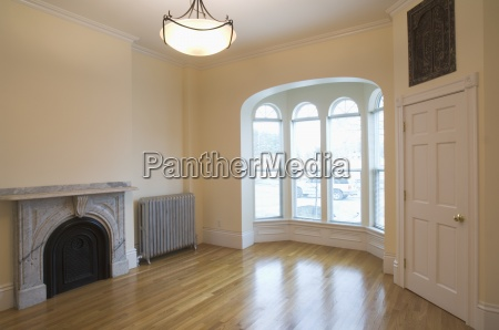 empty room in apartment with hardwood