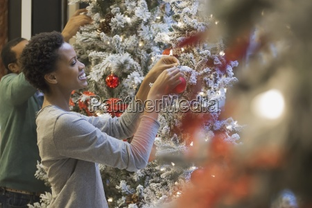 couple at home decorating for holidays