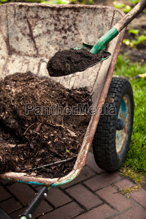 photo of spade putting soil in