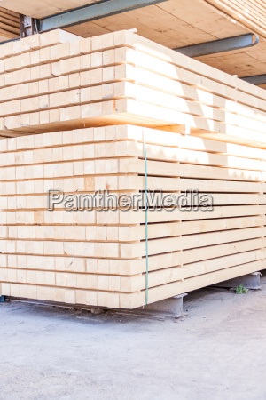 wood panels stacked in stock for