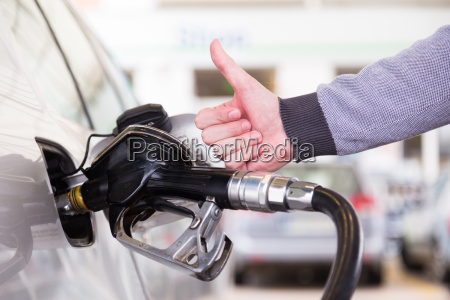 petrol being pumped into a motor