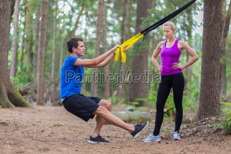 training with fitness straps outdoors