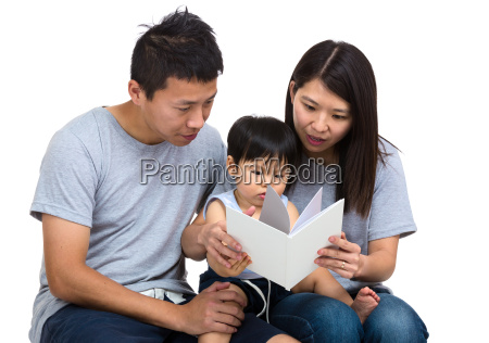 parent reading book with baby son