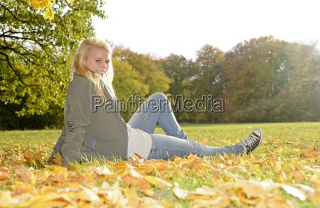 cheerful young woman in the park