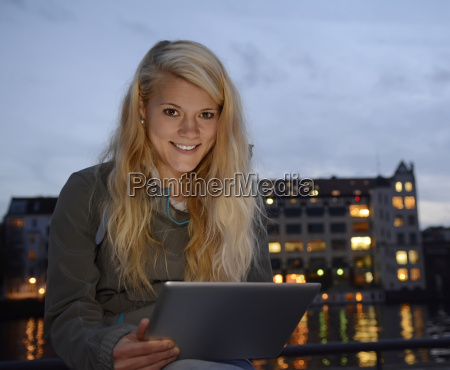 pretty woman with tablet computer