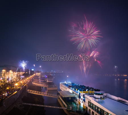 passenger boat with fireworks in background