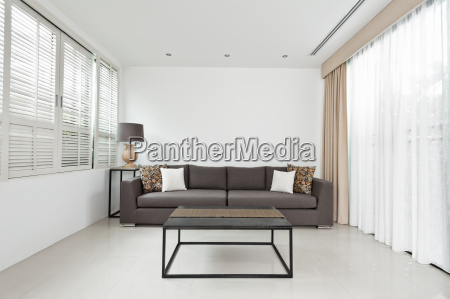 bright living room with grey sofa