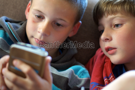 highly concentrated on the smartphone