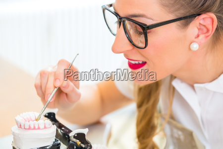 dental technician producing denture