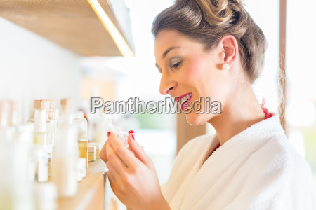woman choosing wellness spa products
