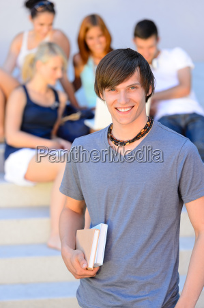 smiling college student boy friends in