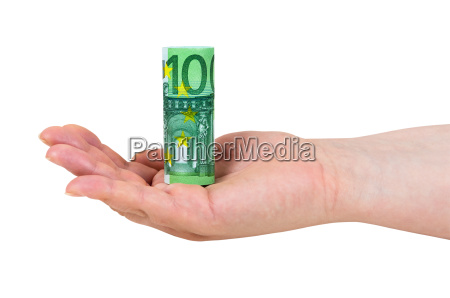 hand holding rolled 100 euro banknote