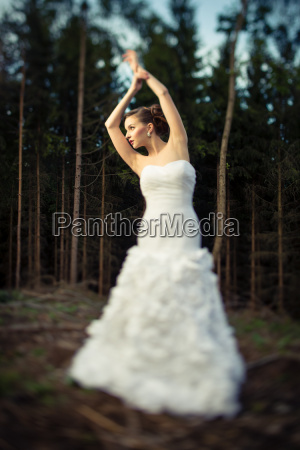 lovely bride outdoors in a forest