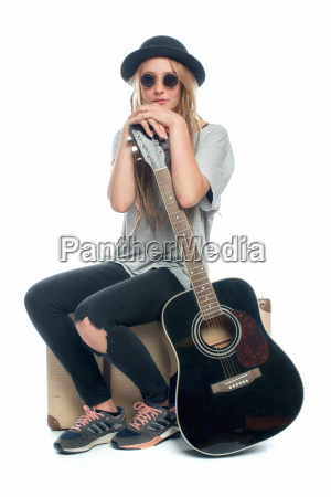 blond girl with hat sitting on