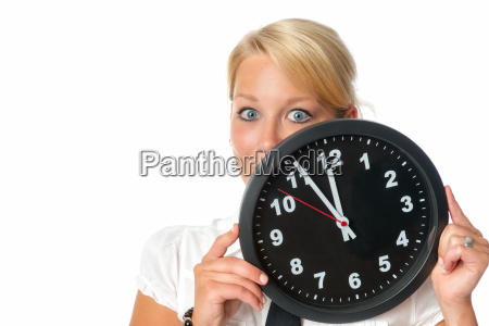 woman is holding a wall clock