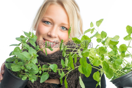 blond woman with medicinal plants